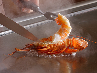 Fresh spiny lobster cooked on a hot steel plate